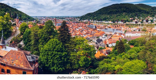 Panoramic view of beautiful medieval town Heidelberg including Carl Theodor Old Bridge, Neckar river, Church of the Holy Spirit, Germany