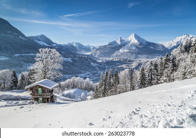 Panoramic view of beautiful mountain landscape in the Bavarian Alps with village of Berchtesgaden and Watzmann massif in the background at sunrise, Nationalpark Berchtesgadener Land, Bavaria, Germany