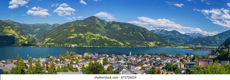 Panoramic view of beautiful mountain landscape in the Alps with the famous town of Zell am See and the idyllic Zeller Lake on a sunny day with clouds and blue sky in summer, Salzburger Land, Austria