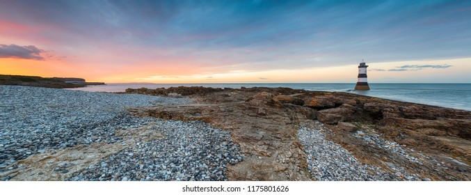 Panoramic view of a beautiful sunset at Penmon Point lighthouse on Anglesey in north Wales