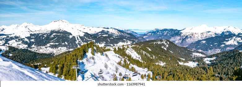 Panoramic view of beautiful winter wonderland mountain scenery in Portes du Soleil, Alps.