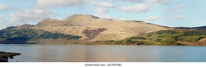 Panoramic view of Ben Lomond (Scotland) over Loch Lomond. The peak of Ptarmigan is prominent on the left.
