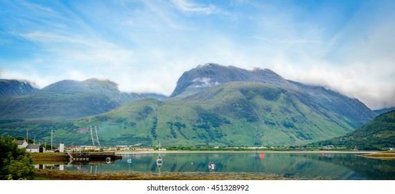 Panoramic view of Ben Nevis, the highest mountain in the British Isles, located at the Grampian Mountains in the Lochaber area of the Scottish Highlands, close to the town of Fort William and Loch Eil