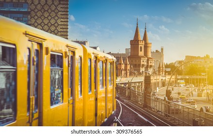 Panoramic view of Berliner U-Bahn with Oberbaum Bridge in the background in golden evening light at sunset with retro vintage Instagram style hipster filter effect, Berlin Friedrichshain-Kreuzberg