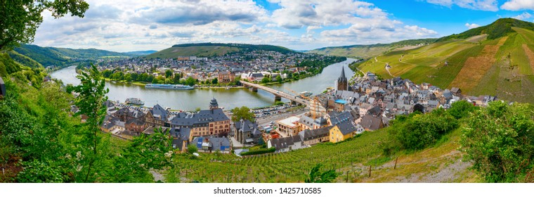 Panoramic view of Bernkastel-Kues and the Moselle river with the surrounding vineyards of the Moselle-valley on a sunny afternoon. Rhineland-Palatinate, Germany. High resolution 50 mpx image.