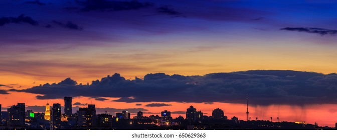 Panoramic view of the big city silhouette against the backdrop of incredibly, awesome bright, multicolour sunset. Kyiv. Ukraine.