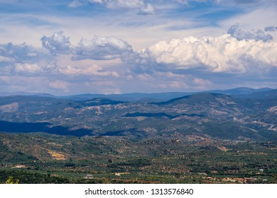 panoramic view from the big height of bird's flight of a rural landscape of mountain hills and the cloudy sky