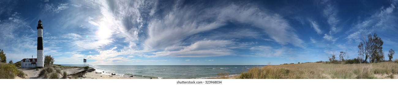 A panoramic view of Big Sable Point Lighthouse late in the day and in the fall season - Ludington, Michigan