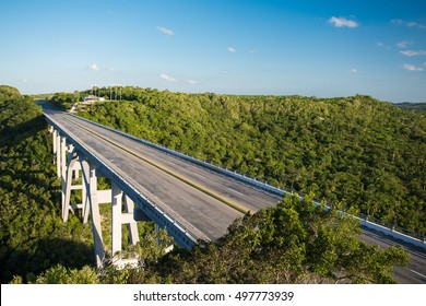 Panoramic view of the big wide deserted empty bridge through the valley of the tropical jungle in hot sunny summer day at province Matanzas