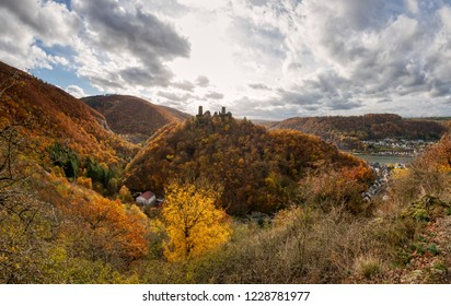 Panoramic view from the Bleidenberg to the hilly landscape of the Moselle valley with the spur castle Thurant on top of a hill near Alken in autumn, Rhineland-Palatinate, Germany