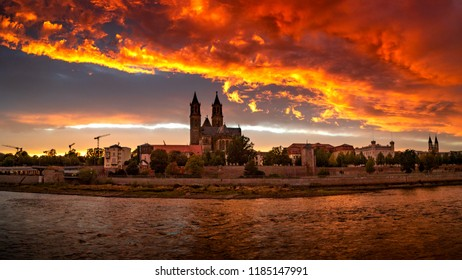 Panoramic view of bloody sunset in front of cathedral in Magdeburg, Germany, Autumn, red cloudy sky