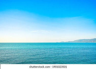 Panoramic view of blue calm sea and blue clear sky in the summer afternoon at the coast of a tropical island. Coastal landscape and seascape at Lipa Noi beach, Samui island, Thailand Selected focus