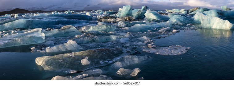 Panoramic view of Jöklusarlon - blue icebergs floating in the lake Jökulsarlon