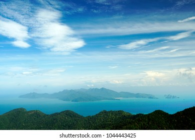 Panoramic view of blue sky sea and mountain seen from Cable Car viewpoint, Langkawi, Malaysia. Picturesque landscape with tropical forest, beaches, small Islands in waters of Strait of Malacca