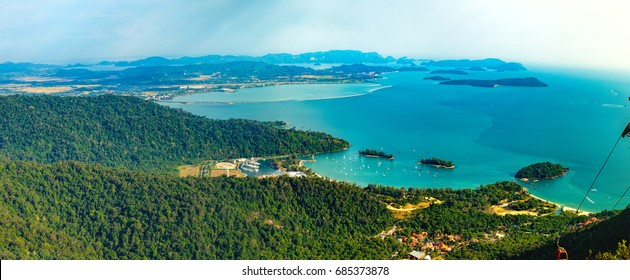 Panoramic view of blue sky, sea and mountain seen from Cable Car viewpoint, Langkawi Island, Malaysia. Picturesque landscape with tropical forest, beaches, small Islands in waters of Strait of Malacca