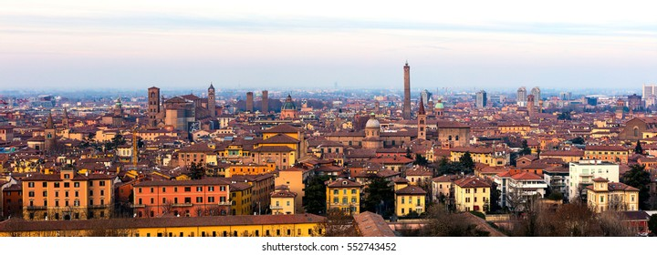 Panoramic view of Bologna, Italy at sunset. Colorful sky over the historical city center with old buildings, the towers Asinelli and Garisenda, and Church