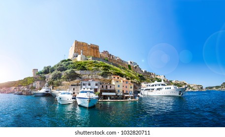 Panoramic view of the Bonifacio port, city, castle and yachts on a sunny summer day.