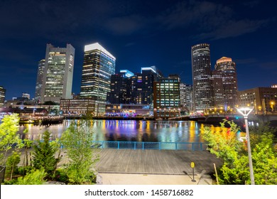 Panoramic view of the Boston Harbor and Financial District at Night.