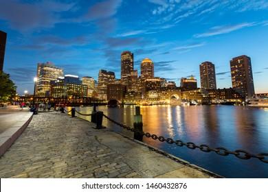 Panoramic view of the Boston Harbor in Boston, Massachusetts, USA at twilight.