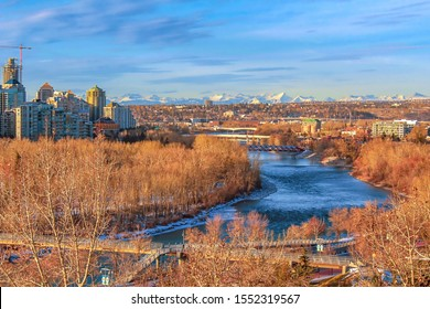 Panoramic view of the Bow river, city and mountains in one shot