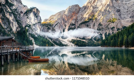 Panoramic view of Braies Lake with the hut and boats in Dolomites mountains and Seekofel in the morning, Sudtirol, Italy
