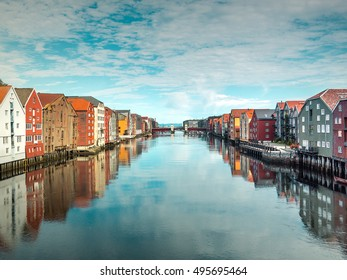 Panoramic view from bridge to famous wooden colored houses in Trondheim city, Norway