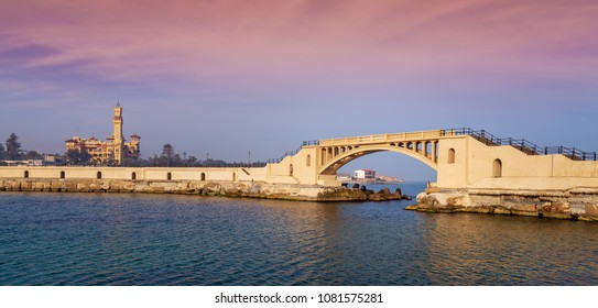 Panoramic view of bridge in the sea at Montazah park with the Royal palace in the far distance with calm sea at sunrise time, Alexandria, Egypt