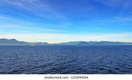 Panoramic view of British Columbia's Coastal Mountain Range in the Rocky Mountains from the approach to Horseshoe Bay from Nanaimo on Vancouver Island, in the Salish Sea.