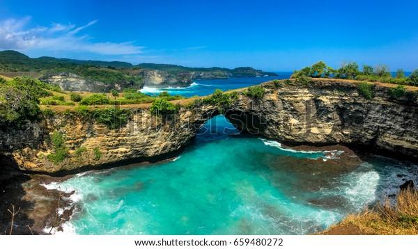 Panoramic view of broken beach in Nusa Penida, Bali, Indonesia. Blue Sky, Turquoise Water.