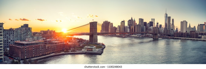 Panoramic view of Brooklyn bridge and Manhattan at sunset, New York City
