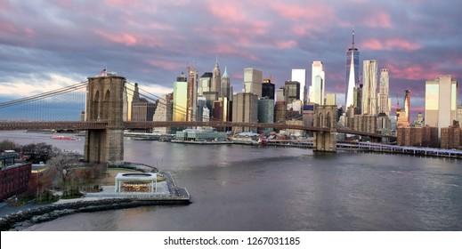 Panoramic view of Brooklyn Bridge at sunrise in New York. USA
