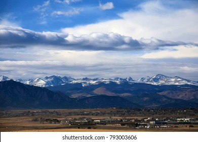 panoramic view from broomfield of the front range mountains of colorado, and dramatic  cloud patterns