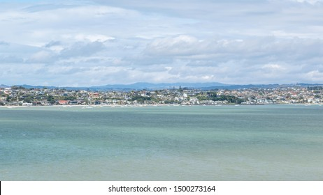 Panoramic view of Bucklands Beach waterfront suburb with Tamaki river in foreground