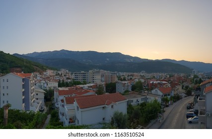 Panoramic view of Budva, Montenegro early in the morning at dawn, the sun is shining from behind the mountains