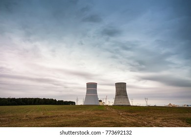 Panoramic view of building of Belarus Nuclear power plant. Nuclear power station in cloudy day with big chimneys. Cooling towers of atomic power plant