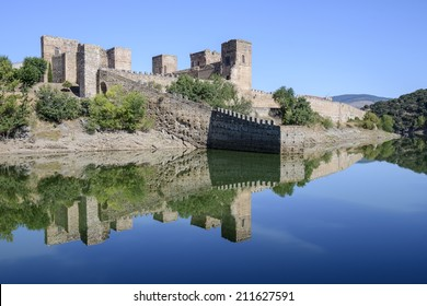 Panoramic view of Buitrago del Lozoya castle and the reflection in the Lozoya river.