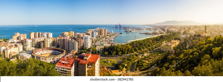 Panoramic view of Málaga with the bullring, the seaport, seafront, the beach and the cathedral. Spain