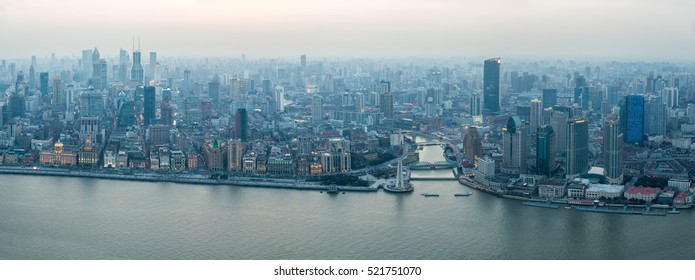 a panoramic view of the bund in shanghai at dusk, China