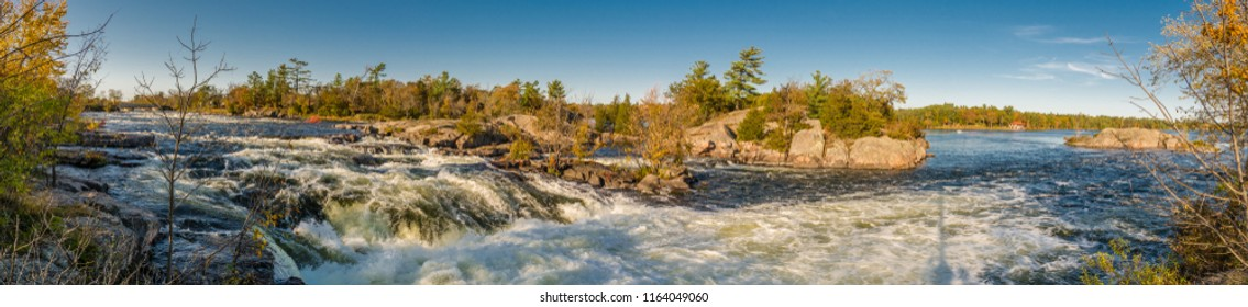 Panoramic View of Burleigh Falls Peterborough Ontario Canada featuring water fall rapids and pink stones