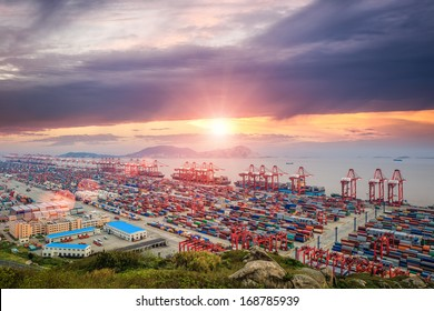 panoramic view busiest container port in sunset