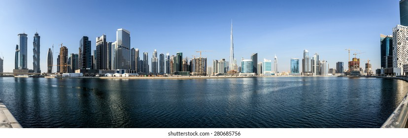 Panoramic view of business bay and downtown area of Dubai reflection in a river.