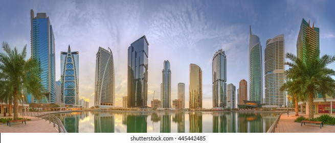 Panoramic view of Business bay and Lake Tower, reflection in a river, UAE.