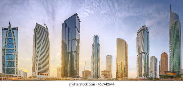 Panoramic view of Business bay and Lake Tower, reflection in a river, Dubai UAE.
