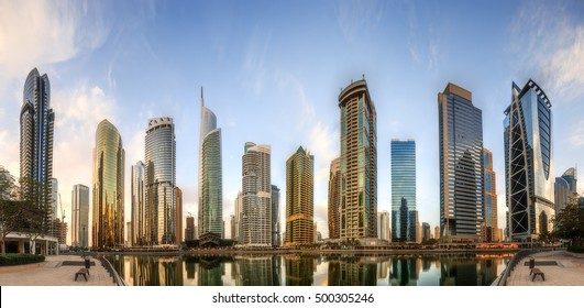 Panoramic view of Business bay and Lake Tower, reflection in a river, Dubai, UAE.