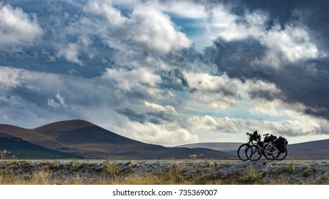 Panoramic View of bycicles on horizont with amazing clouds