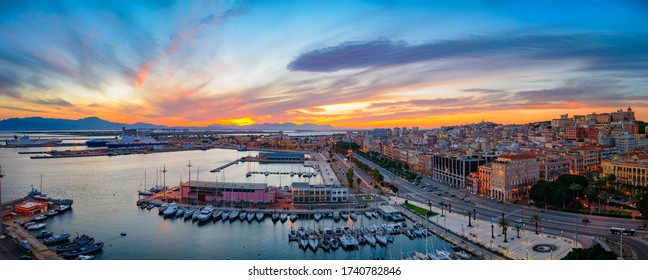 Panoramic view of Cagliari city and harbor at sunset. Aerial panoramic view of Casteddu. - Shutterstock ID 1740782846