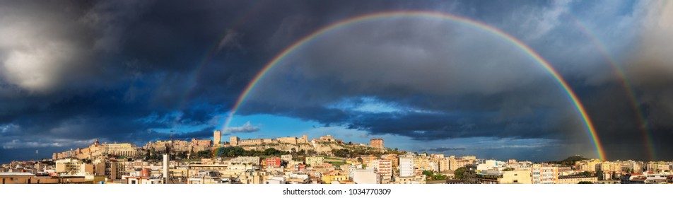 Panoramic view of Cagliari with rainbow after the rain