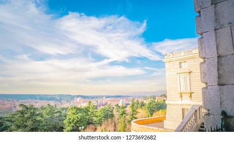 Panoramic view of the Campo del Moro, Casa de Campo parks and Madrid city views from the Royal Palace downtown Madrid, Spain at sunset with beautiful blue sky and clouds.
