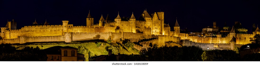 Panoramic view of Carcassonne fortress from Aude river in evening, France