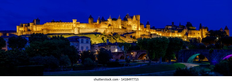 Panoramic view of Carcassonne France, fortress from Aude river in evening, blue hour